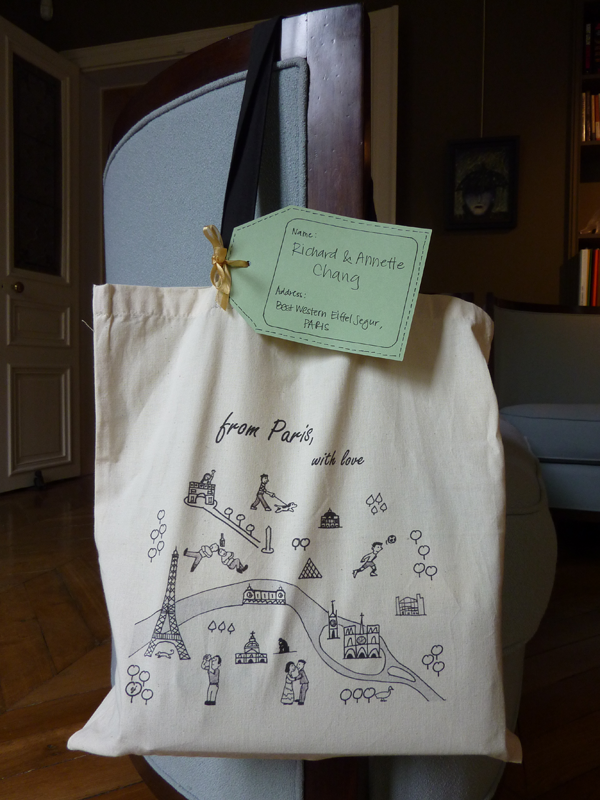 Welcome bag for wedding guests with an itinerary and snacks for a Paris destination wedding by destination wedding planner Mango Muse Events