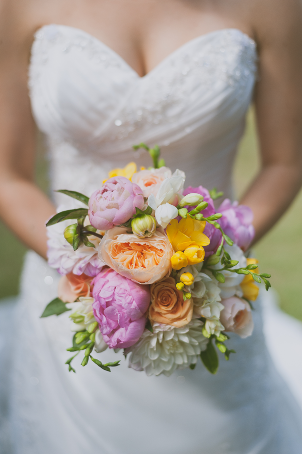 Sherbert colored bouquet for a spring wedding by destination wedding planner Mango Muse Events