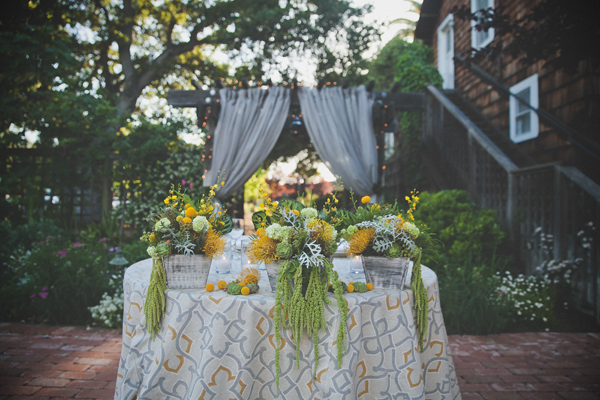 Yellow and green floral centerpiece for a spring wedding by destination wedding planner Mango Muse Events