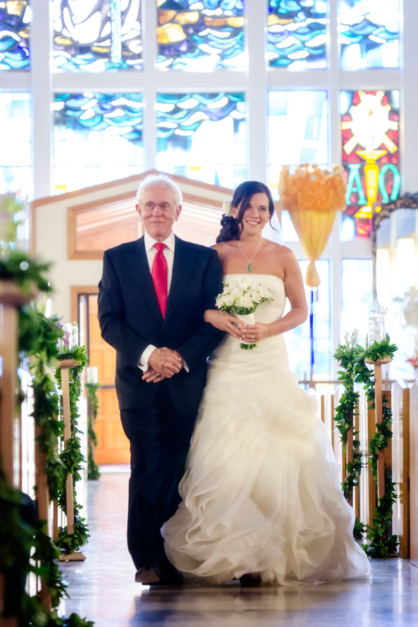 Bride and her father walking down the aisle at a church wedding for a destination wedding in Hawaii designed by Destination wedding planner Mango Muse Events