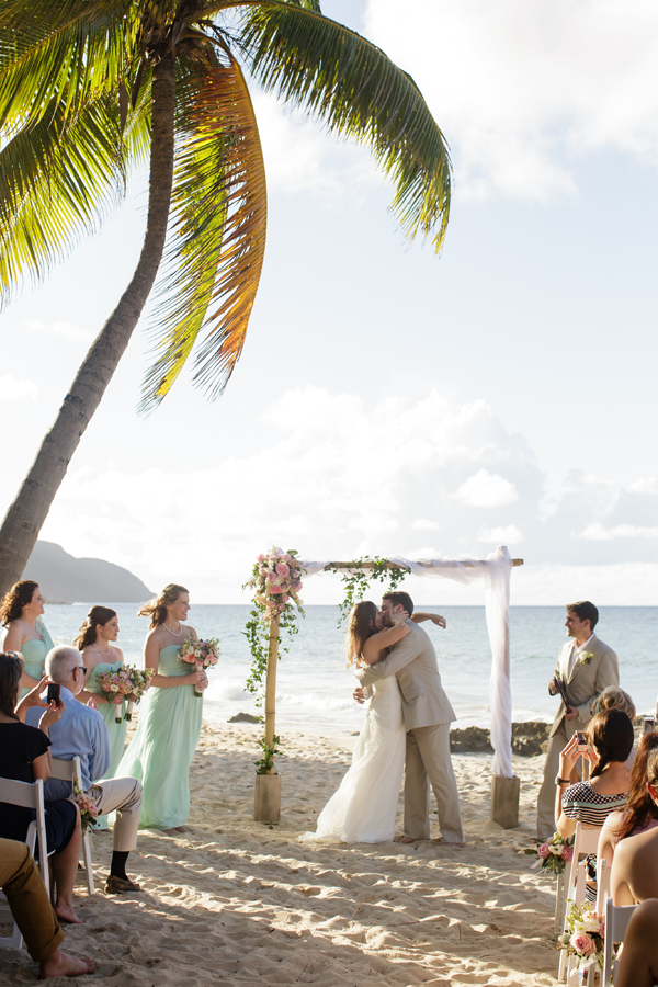 Beach wedding ceremony on St. Croix at a Caribbean destination wedding by Destination wedding planner Mango Muse Events